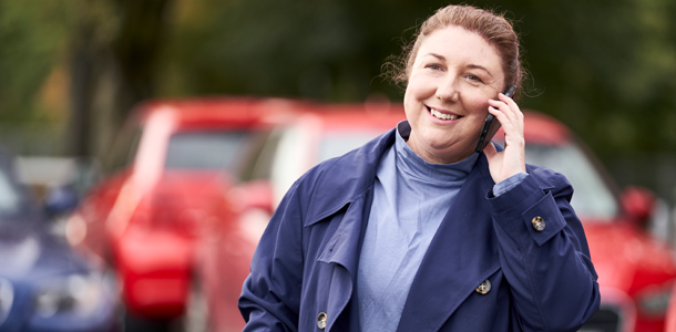 Lady talking on Mobile telephone
