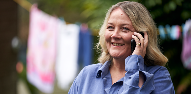 Lady talking on Mobile telephone, washing line in background