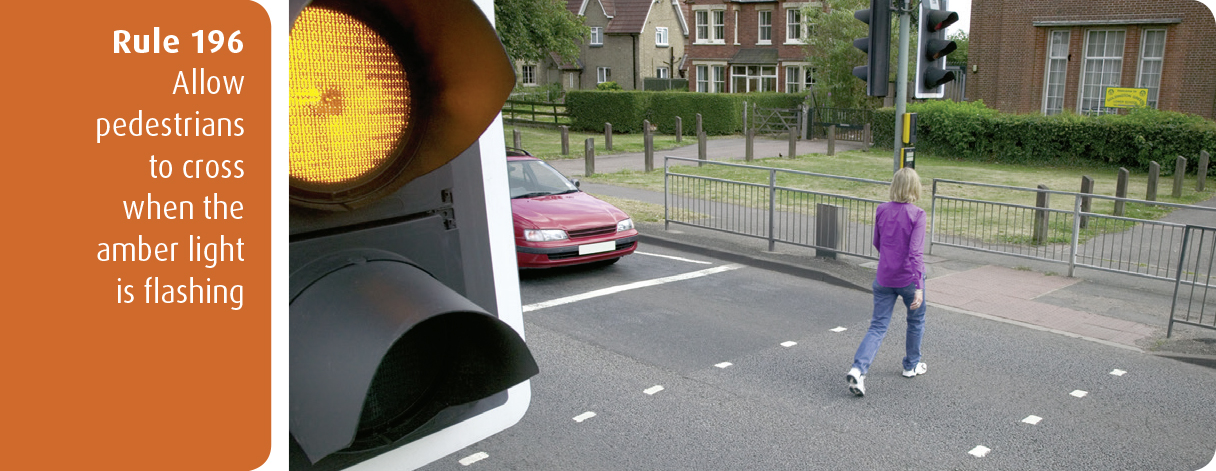 Highway Code for Northern Ireland rule 196 - allow pedestrians to cross when the amber light is flashing