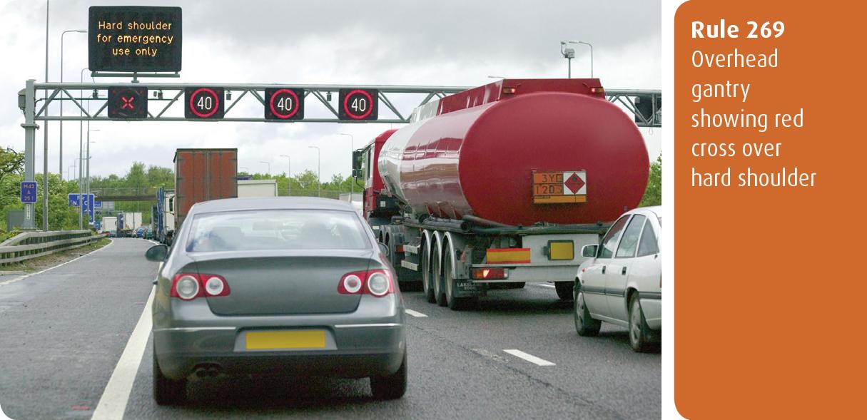 Highway Code for Northern Ireland rule 269 - overhead gantry showing red cross over hard shoulder